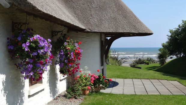 The Cottages at Bettystown, Co Meath, is a collection of six quaint thatched cottages with vaulted oak-beam ceilings and open fireplaces