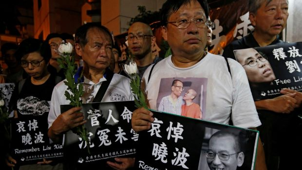 Pro-democracy activists mourn the death of Nobel Laureate Liu Xiaobo outside China's Liaison Office in Hong Kong, China, July 13th, 2017. Photograph: Bobby Yip/Reuters