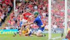 Cork's Alan Cadogan scores the opening goal against Clare in the Munster final. Photograph: Cathal Noonan/Inpho