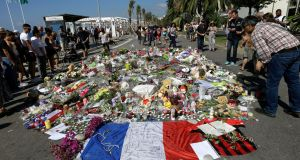 People look at flowers placed on the Promenade des Anglais in Nice, France, at the scene of the Bastille Day  truck attack in July last year. File photograph: Claude Paris/AP Photo