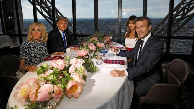 Restaurant le Jules Verne: Brigitte Macron, President Trump, Melania Trump and President Macron at the Eiffel Tower for dinner. Photograph: Kevin Lamarque/Reuters