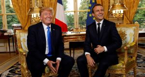 Bonhomie: President Trump and President Macron in Paris on Thursday. Photograph: Kevin Lamarque/Reuters