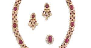 Lot 180, the Collection of Raine, 18ct gold, ruby and diamond parure by Van Cleef & Arpels  made £221,000 at Christie's of London