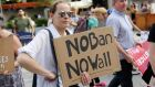 A protester holds a sign reading 'No Ban, No Wall' at a protest against US president Donald Trump's limited travel ban. Photograph: Reuters