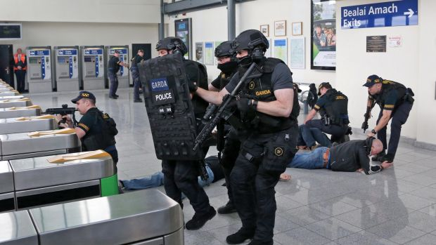 Members of the Garda Armed Support Unit (ASU) at Spencer Dock Train Station during the simulated terrorist attack. Photograph: Collins