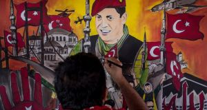 Taksim Square: a man puts the finishing touches on a painting depicting Turkey's attempted coup of July 15th, 2016. Photograph: Chris McGrath/Getty