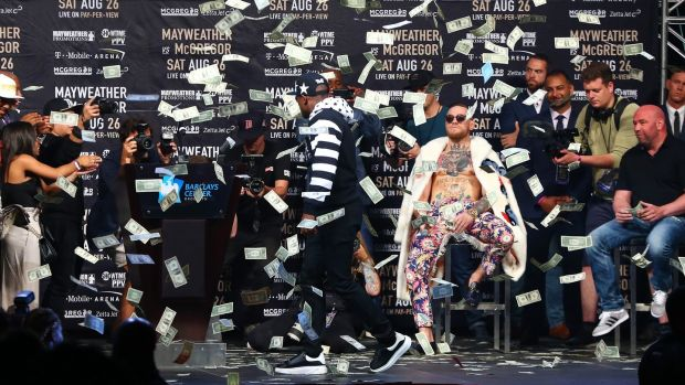 Mayweather showers McGregor with money. Photo: Mike Stobe/Getty Images