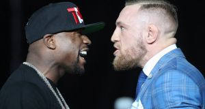 Floyd Mayweather and Conor McGregor stare each other down during a world tour press conference this week. Photograph: Tom Szczerbowski