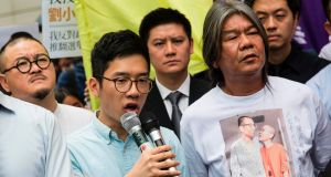 Pro-democracy lawmakers Nathan Law and Leung Kwok-hung  speak to the media before the verdict was handed down. Photograph: Isaac Lawrence/AFP/Getty Images