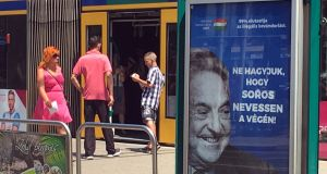 "Hungarian government poster that reads ""Don't let George Soros have the last laugh"", in Budapest. Photograph: Krisztina Than/Reuters"