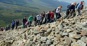 "People climbing Croagh Patrick in Co Mayo: ""Visitor management"" and the impact on the mountain is key to its future sustainability and conservation works.  Photograph: Eric Luke"