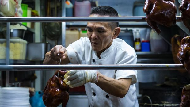 Chan Hong Meng prepares his Hong Kong Chicken Rice and Noodle stall for opening in Singapore