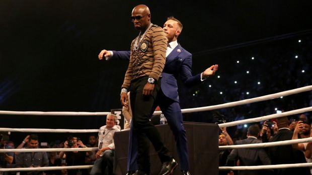 McGregor dances behind Mayweather during the press conference at the SSE Arena, Wembley. Photo: Scott Heavey/PA Wire