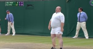 The strict Wimbledon dress code meant Mr Quinn had to beat himself into a little white skirt and long sleeve top, courtesy of Clijsters. Photograph: Wimbledon/Youtube