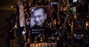People attend a candlelight march for the late Chinese Nobel laureate Liu Xiaobo in Hong Kong on Saturday. Photograph: Getty
