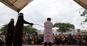 An Indonesian man is publicly caned on May 23rd in Banda Aceh, Aceh province, Indonesia, for having gay sex. Photograph: Beawiharta/Reuters