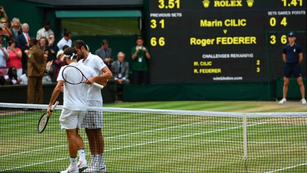 Roger Federer and Marin Cilic shake hands after the Swiss had completed a straight sets win in the Wimbledon final. Photograph: Glyn Kirk/AFP