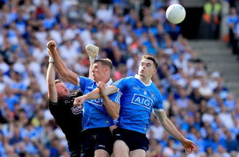 CAPITAL GAINS: Dublin's Paul Mannion and Brian Fenton with Mark Donnellan of Kildare during the Leinster SFC final at Croke Park. Dublin won 2-23 to 1-17 to claim their seventh title in a row. Photograph: Donall Farmer/Inpho