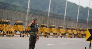 A South Korean soldier at a checkpoint near the Demilitarised Zone. Photograph: Jeon Heon-Kyun/EPA