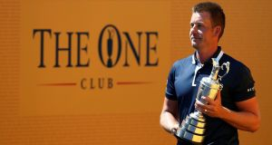 Defending British Open champion Henrik Stenson with the Claret Jug ahead of this year's tournament at Royal Birkdale. Photograph: Paul Childs/Reuters