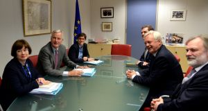 European Union's chief Brexit negotiator Michel Barnier and his delegation with their briefing papers sit across from  Britain's Secretary of State for Exiting the European Union David Davis and his delegation at the talks on Brexit. Photograph: Reuters