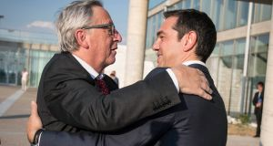 Greek prime minister Alexis Tsipras (r) and European Commission president Jean-Claude Juncker. Photograph: Andrea Bonetti/EPA