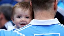 Kevin McManamon with his seven-month-old  nephew Liam after Dublin won their seventh straight Leinster football title at Croke Park on Sunday. Photograph:  Tommy Dickson/Inpho