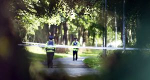 Gardaí at the scene at Coolmine Woods where the remains of the woman  were discovered shortly after 2pm. Photograph: Collins