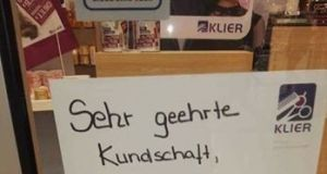 The sign in the window of a hairdresser's shop in Zwickau, eastern Germany, that sparked abuse and calls to boycott the salon.