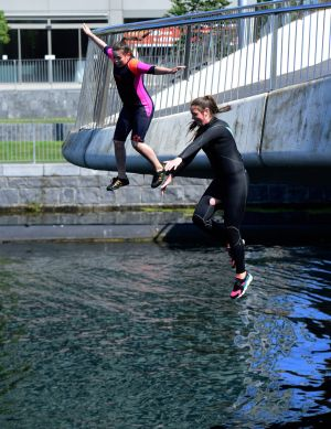 TEST THE WATER: Girls jump into the Royal Canal in Co Dublin to cool off. Photograph: Cyril Byrne/The Irish Times