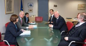 EU chief Brexit negotiator Michel Barnier (second from left) and UK Brexit secretary David Davis (second from right) prepare with officials for talks at the EU headquarters in Brussels on Monday. Photograph: Jennifer Jacquemart/EU/PA Wire