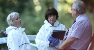State Pathologist Marie Cassidy (l) at the scene  in west Dublin where the remains of a woman were discovered on Monday. Photograph: Collins