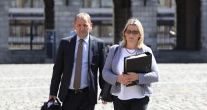 Sgt Maurice McCabe with his wife, Lorraine, at the Charleton tribunal in Dublin Castle, on Monday.  Photograph: Collins Photos