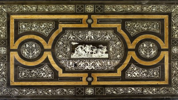 Early 19th century Italian ebonised centre table, the top decorated profusely with inlaid ivory including images of Neptune and Venus