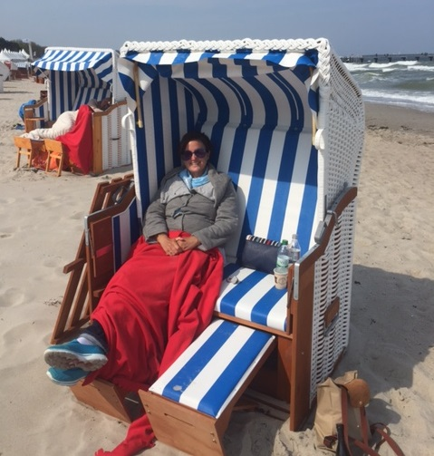 Michelle enjoying the sun on a 'strand korp' on Timmendorfer Strand.