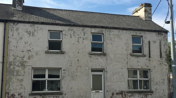 On Pound Street, Ballaghaderreen an end of terrace fourbedroom house for sale at €49,000