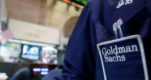 A trader works at the Goldman Sachs stall on the floor of the New York Stock Exchange. Photograph: Reuters