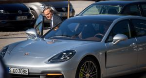 Oliver Blume, chief executive officer of Porsche AG, gets into a Porsche Panamera 4 E-Hybrid: He said Porsche will decide at the end of the decade whether its latest generation of diesel engines will be its last.
