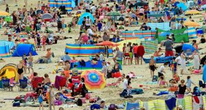 AT SEA: Crowds enjoy the good weather at Brittas Bay, Co Wicklow. Photograph: Nick Bradshaw
