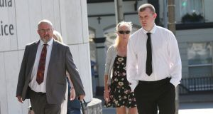 Alan McNamara (left), of Mountfune, Murroe, Co Limerick, his wife May (centre) and his stepson, Robert Cusack,   at the Central Criminal Court in Dublin this morning. Mr McNamara has pleaded not guilty.  Photograph: Collins Courts