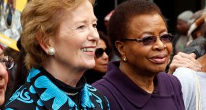 Former Irish president Mary Robinson and Graça Machel, widow of former president Nelson Mandela, join a walk to commemorate what would have been Mandela's 99th birthday in Cape Town, South Africa. Photograph: REUTERS/Mike Hutchings