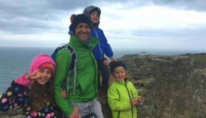 James Parnell with his three children in Howth: 'I love Ireland and Australia for being places worth longing for.'