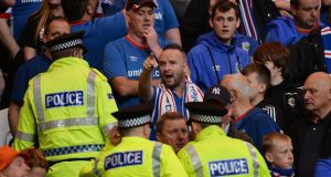 Police officers and stewards go into the Linfield supporters section as tempers flare during the Uefa Champions League clash against Celtic. Photo: Mark Runnacles/Getty Images