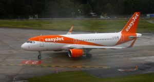 An EasyJet aircraft is ready for take off at Cointrin airport in Geneva, Switzerland. Photograph: Reuters