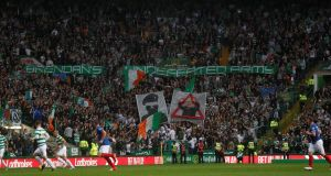 Celtic fans display banners during their comprehensive win over Linfield. Photograph: Russell Cheyne/Reuters
