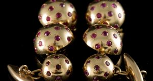 Lot 64:  domed studs and spherical bead cufflinks set throughout with round faceted rubies, mounted in 18ct gold