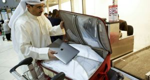 Kuwaiti social media activist Thamer al-Dakheel Bourashed putting his laptop inside his suitcase at Kuwait International Airport  before boarding a flight to the US earlier this year.