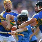 Tipperary's Padraic Maher and Dan McCormack put the shackles on Dublin's  Donal Burke. An outclassed Dublin still managed to score 1-19 on the day. Photograph: Cathal Noonan/Inpho