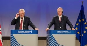 The EU chief Brexit negotiator Michel Barnier, right, and British secretary of state David Davis address the media after a week of negotiations at EU headquarters in Brussels. Photograph: AP Photo/Geert Vanden Wijngaert