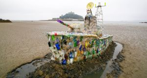 A 30ft model of a warship made entirely of plastic marine litter on Marazion Beach in Cornwall. The ship was made by campaign group Surfers Against Sewage, to highlight the growing threat of throwaway plastic. Photograph: Geoff Caddick/PA Wire.